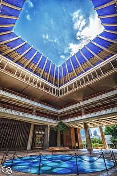 Hawaii State Capitol Building. Instead of a traditional rotunda, the Hawaii State Capitol building just opens up to the sky.