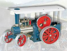 """The Wilesco D415 Steam Traction Engine Kit is fully operational kit, for the enthusiast.  Mirror polished and nickel plated boiler, with a diameter of 1.8"""", length 7.3"""", boiler capacity 14 in, with water gauge glass.  Double action reversible brass cylinder, with flywheel, spring loaded safety valve, steam regulator, steam whistle, steam jet oiler and footbridge.    Smoke stack, traditional steering wheel chain drive.  Flywheel with a diameter of 3.2"""" with grooved pulley."""