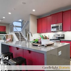 Salt Lake Parade of Homes, Candlelight Homes, Snowmass Design, Independence At The Point, Kitchen, Cabinetry, Red cabinets, cupboards, Waterfall island, waterfall countertops, kitchen island, stainless steel appliances, great room, rail, barstools, stools