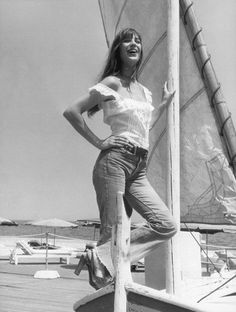 Jane Birkin strikes the perfect balance in white peasant flounces and high-waisted denim. Côte d'Azur, 1973. Courtesy of Getty.