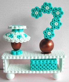 Doll accessories made with perler beads - A bench with a lamp and a sculpture…