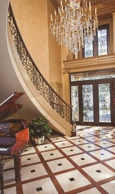 French style foyer designed by Tracy Rasor, Dallas Design Group Interiors, and built by Sharif and Munir Custom Homes, with Solara Doors and Regency Railings.