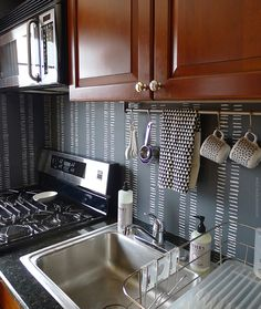 hand painted (and removable!) kitchen backsplash in the apartment :: via door sixteen