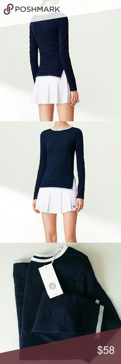 ❤NWT Tory Burch Sport - Long Sleeve Top - SM The perfect balance of elegant lines and technical ingenuity, the navy Seamless Side-Slit Top with contrast trim is engineered using a special knitting technique to create an extra-comfortable and flattering fit. The result is a performance piece that is anti-chafing, breathable and ultra-pliable. Fits true to size; take your normal size.  Fitted.  Crewneck. Reflective logo detail.  STILL IN STORES FOR $95! Tory Burch Tops Tees - Long Sleeve