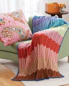 Rippled knit afghan in a subtly colorful stripe pattern. Shown in Bernat Satin.