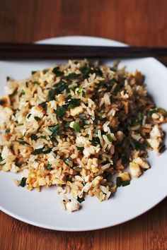 An authentic and basic Chinese-style egg fried rice, with 'eggs' (tofu scramble), chives, and soy sauce. Yummy on it's own or with more vegetables added!