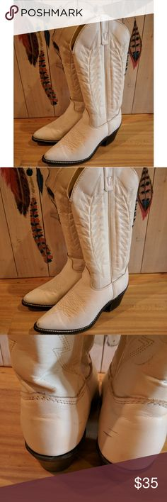 Beautiful vintage white western boots These white cowboy boots are in great vintage condition. There are some scuffs (see pics) but for such light colored boots it's very minimal. Lots of life left in these babies. Made in the USA by the Texas boot company. Vintage Shoes Heeled Boots