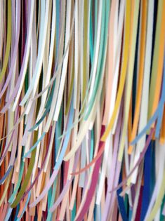 paint chip art....you could drop the chips through a shredder to get ribbons of colored paper!