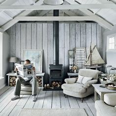 white-washed cottage on the Cornish coast - Yes, it looks a little chilly. But! It's beautiful, it's serene, and as smart people in the comments pointed out, add some green houseplants and an orange cat and suddenly it's much more alive.  Plus, that comfy low armchair is calling my name...