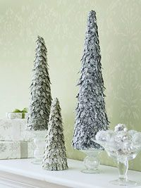 Twinkling Trees: A Do-It-Yourself Christmas Tabletop Idea. Use your Cricut to cut out the leaf shapes!