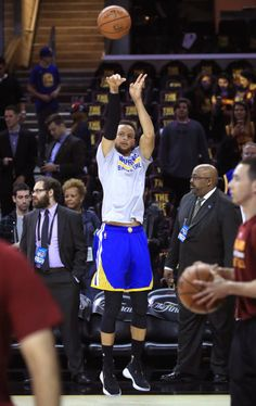 Stephen Curry of the Golden State Warriors warms up before Game 3 of the 2017 NBA Finals against the Cleveland Cavaliers at Quicken Loans Arena on...