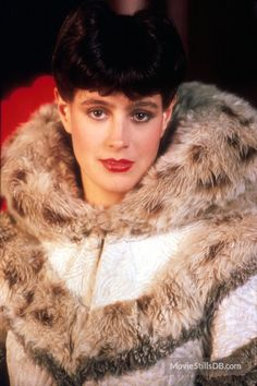 """Sean Young was supposed to play Vicki Vale in """"Batman,"""" but broke her arm while horseback riding and had to give up the role. But she had achieved leading lady status earlier in the decade, playing Rachael in dystopian sci-fi flick """"Blade Runner. Sean Young Blade Runner, Rachel Blade Runner, Film Blade Runner, Blade Runner 2049, Classic Movie Stars, Classic Films, Sci Fi Films, Pulp, Young Actresses"""