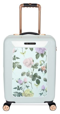 Travel in style with this mint vintage-inspired suitcase featuring pretty pastel blooms.