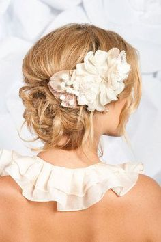 Wedding hair updo....not sure what the front of her dress looks like but i LOVE the ruffled collar!!