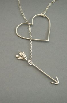 I've got your name tattooed in an arrow heart...idk the necklace just reminded me of this lyric
