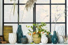 Style Your Place Like A Home Catalog — All The Tricks #refinery29  http://www.refinery29.com/2014/07/70895/west-elm-fall-2014-collection#slide-7  A vase collection gets proper showing on a window sill. ...