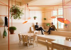 Overtreders W installs pipework above heads of customers in Dutch cafe