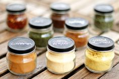 Baby food jars repurposed. Paint lids with chalkboard paint and use to store spices.