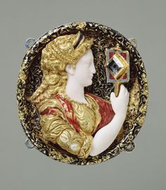 Hat Badge Representing Prudence. Artist/Maker(s): Unknown. Culture: French. Place(s): France (Place created). Date: 1550 - 1560. Medium: Gold, enamel (white, blue, red and black), chalcedony, and glass in the form of a table-cut diamond.