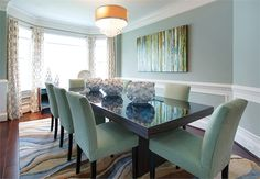 A warm, vibrant color scheme is the backdrop for large gatherings in a sleek, elegant dining room.