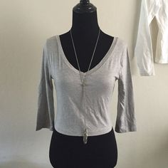 Bundle 2 crop tops ️️TRADES‼️Crop top bundle. One grey top, v neckline front and back 3/4 length sleeves. 93% rayon 7% elastane. In great condition. Second is a white crop top with a scoop neckline front and back. The back neckline is deeper then front, long sleeves, 98% cotton 2% elastane, this one is new with tag. Tops Crop Tops