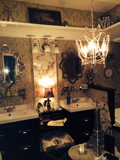 3/4 wall by my sink perfect for hot curlers, close up mirror. Pier1 mirrors, Ikea cabs roll out drawers really deep, antique handles I painted silver, ikea sinks and Ikea table cut up to make center vanity. ($4.99) I know! Ikea chandelier and Ikea shelves added to make soffit interesting and increase the look of high ceilings. Merlinsowl.