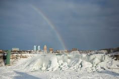 A rainbow appears over the partially frozen American Falls in sub-freezing temperatures, as seen from Niagara Falls, Ontario, Canada, on February 17, 2015. © Lindsay DeDario/Reuters
