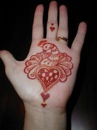 henna tattoo red with hearts