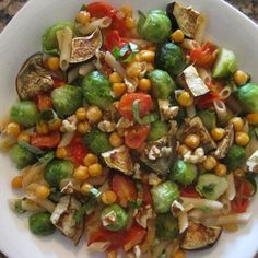 Ingredients: 1/2 C chunked eggplant 1 C halved baby Brussels sprouts 1/2 C chickpeas 1/2 C minced onion 1/2 T EVOO 1/2 T minced garlic 12 grape tomatoes, halved 1/2 C cooked brown rice pasta 3 lg fresh basil leaves, sliced  oven to 350 degrees. Place eggplant, Brussels sprouts,  and chickpeas on a cookie sheet. Mist with cooking spray and roast for 20 minutes.