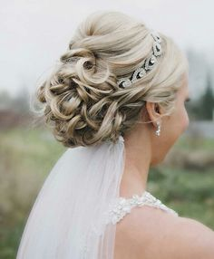 Pretty Updo Along With Crystal Headpiece/Halo & Veil