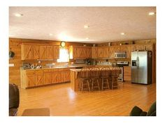 Gorgeous ranch home designed and built for the busy family who savors the outdoors and country living yet enjoys extra-nice indoor comforts and amenities. Open floor plan with stunning cabin-style beauty. So spacious yet all flows together for a carefree intimate cabinranch feel. 3 living areas.  Wonderful master suite. Covered upper deck provides great ranch views. 30x50 painted metal shopequip building - big enough for all those big-boy toys. 42x40 livestock barn plus 3 additional ranch…