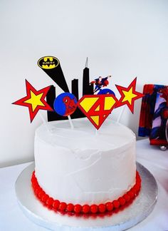 Easy super hero birthday cake with printable DIY cake toppers - Batman, Superman, Spider-Man and Wonder Woman. And wait until you see what it looks like inside once it's cut! #superhero #birthday #kidsbirthday #superherobirthday #cake #diy #birthdayparty #superman #spiderman #batman
