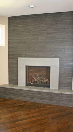 Modern Brick Fireplace; porcelain tile clad, solid surface slab on ...
