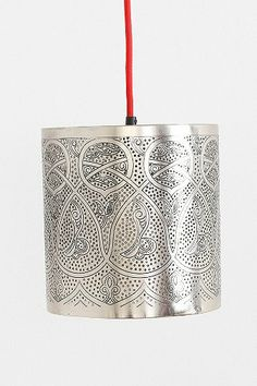 This beautifully etched lamp will create a warm, soft glow through the room and project streams of light through mini cutouts along the body of the design, complimenting the exotic atmosphere of the room.