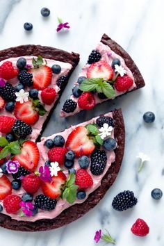 A Flourless brownie is topped with whipped coconut cream mixed with raspberries and fresh berries. A fun and delicious way to enjoy dessert!