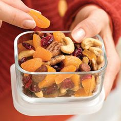 Healthful Fruit-and-Nut Mix    1 9 1/2-ounce can mixed nuts  1 6-ounce container smoked almonds  1 cup quartered dried apricots   3/4 cup dried cranberries