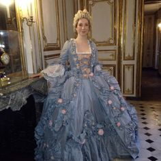 Madame de Pompadour 18th century robe a la Francaise and tete de mouton hair style.