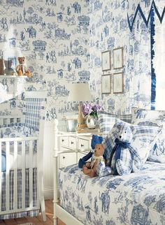 What a charming nursery with all the animals in the toile and the classic blue and white color scheme. The window treatment is especially fresh.