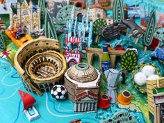 Sara Drake - Rome and Tivoli detail from a large illustrated map of Italy - papier mache, acrylic paint, balsa wood and mixed media.