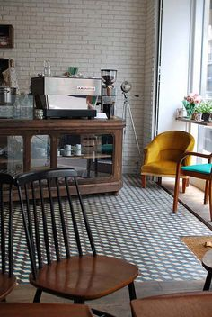Merce and the Muse | Paris. Love the tile and the glass cabinet. http://w1p.fr/129507