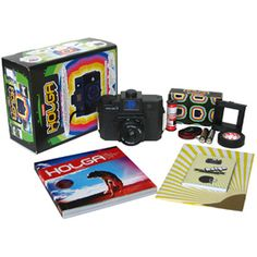 Holga Camera Starter Kit. $75.00. Medium-format, all-plastic camera. Built-in flash. Ages 12 and older. Includes Holga 120 CFN Colorflash camera, 120 mm film, 1 roll opaque tape, 2 AA batteries, a 194-page photo book, and a multi-lingual instruction manual.