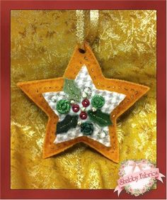 "Wool Christmas Ornament Kit - Star: Create a beautiful heirloom quality ornament to decorate your tree year after year! Kit includes pattern, 100% wool fabric, silk and metallic ribbon, embellishing beads and buttons, and instructions to complete a wool star ornament measuring approximately 5"" X 5"". Please note no thread is included."