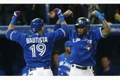 Toronto Blue Jays right fielder Jose Bautista, left, celebrates his home run Thursday, alongside shortstop Jose Reyes at the Rogers Centre in Toronto. Blue Jay Way, Go Blue, Baseball League, Baseball Players, Toronto Blue Jays, Baseball Pants, Baseball Shirts, Baseball Toronto, Best Baseball Games