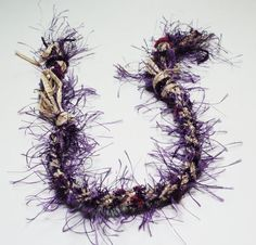 """Grab everyone's attention with this eyelash yarn bracelet. The """"fuzziness"""" does not come off! It's attached right to the yarn and then braided into the bracelet. Don't have to worry about it flaking all over your outfit."""