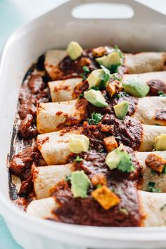 Spicy Tofu Vegan Enchiladas | Delicious enchiladas filled with crispy tofu, black beans and diced tomatoes | thealmondeater.com