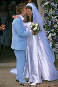 Aw, how cute is this?! Jamie Oliver wore a baby blue suit (and snake-inspired shoes...) whilst his blushing bride Jools looked stunning in a silky strapless gown.