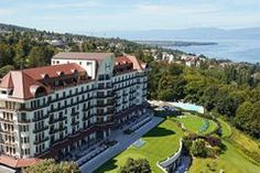Relaxing at the french restaurant L'OLIVERAIE of the luxury 5-star palace Hotel ROYAL Evian (France, Europe). Enjoy the swimming pool and the menu!