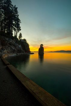 siwash rock winter susnet - A cold winter night at sunset at siwash rock on Vancouver's seawall right in the middle of the city yet no one is here.