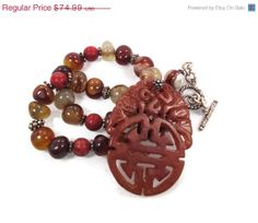 ON SALE Carved Orange Jade Pendant & Stone by InVintageHeaven, $67.49