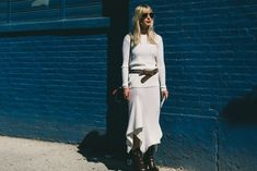 white skirts in winter, hankerchief hemline skirt, black booties, belted sweater, black and white, kerry diamond, editor style, style hack, fall outfits-putty-offf white-grey-asymmetrical hankerchie hemline skirt-western belt-booties-fall outfits-work outfits-nyfw-fall outfits-via-racked